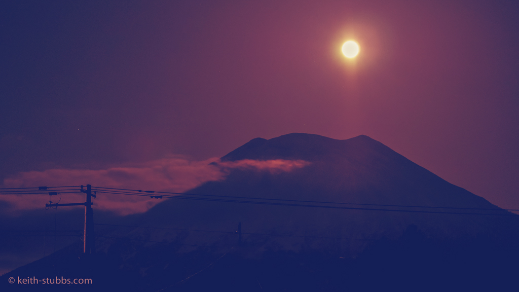 The moon rising over Mount Yotei, in Niseko