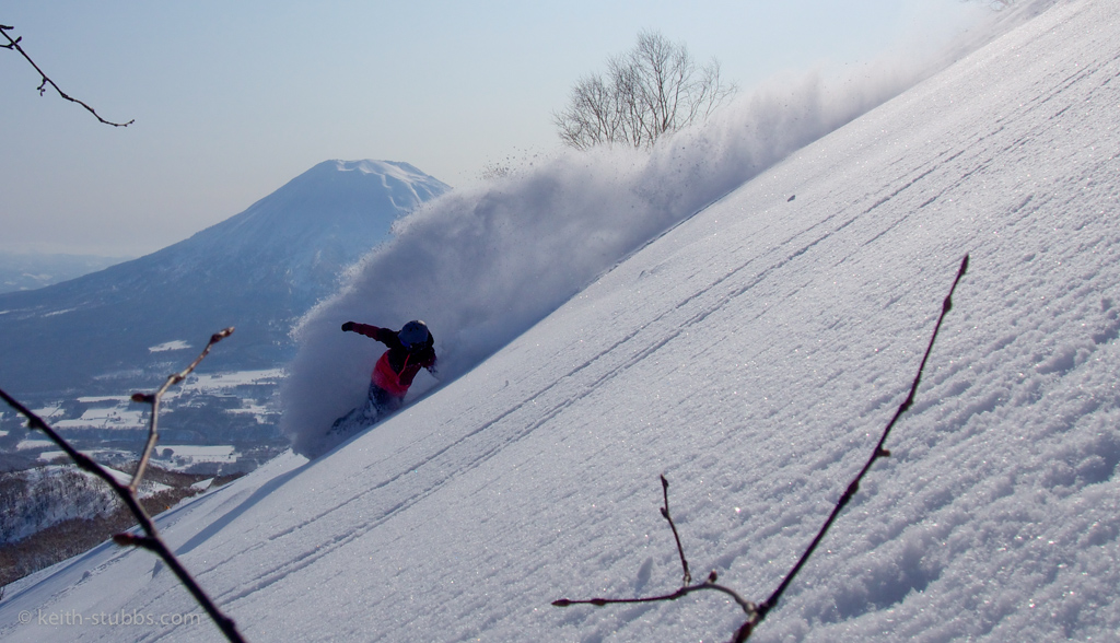 Stuart Tyrwhitt scoring fresh pow lines in Niseko, with Mt Yotei in the background